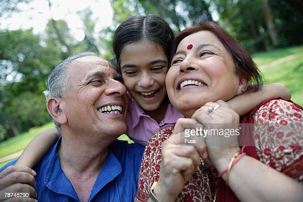 Happy Grandparents with Girl Outside