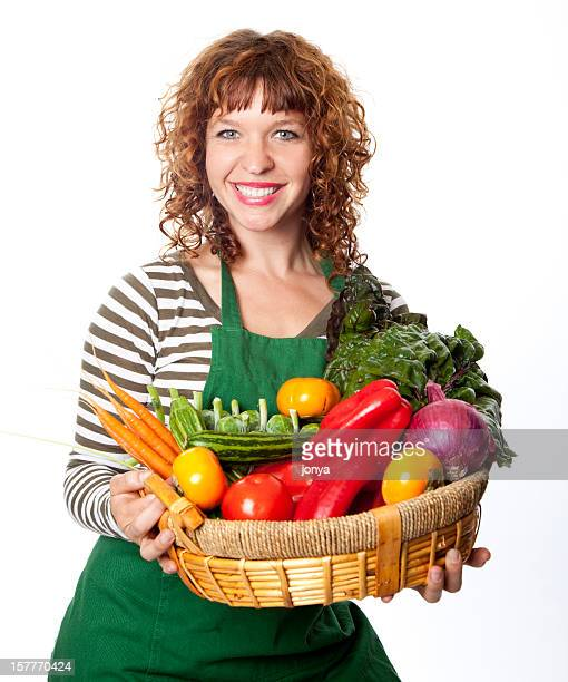 happy green grocer with basket of vegetables