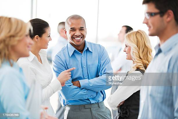 Happy group of businesspeople laughing