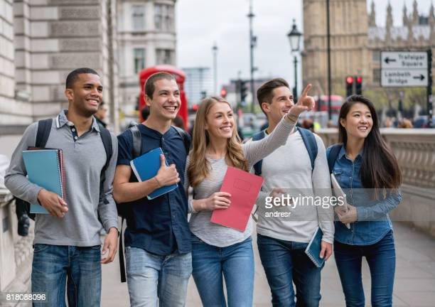 Happy group of exchange students walking in London