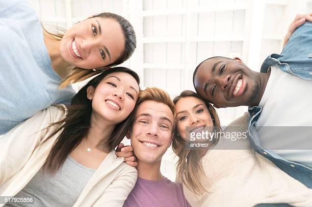 Happy group of flat mates at home
