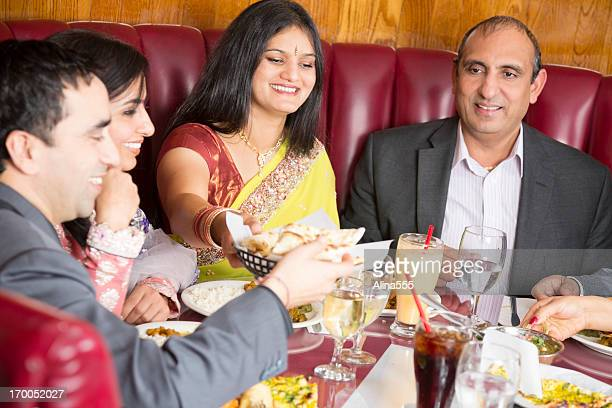 Happy group of friends at an indian restaurant