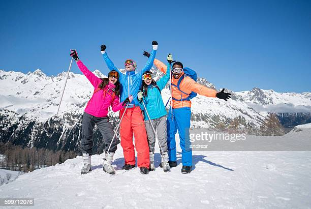 Happy group of friends skiing