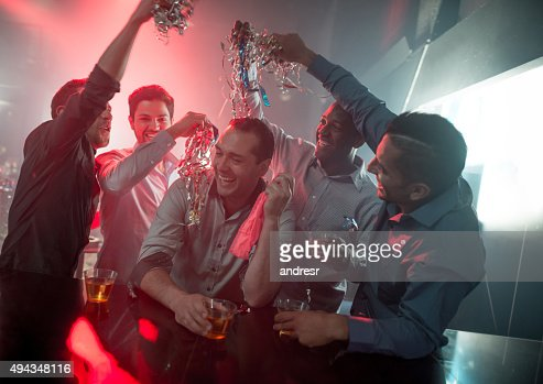 Happy group of men at a bachelor party