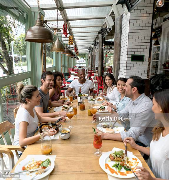 Happy group of people at a restaurant