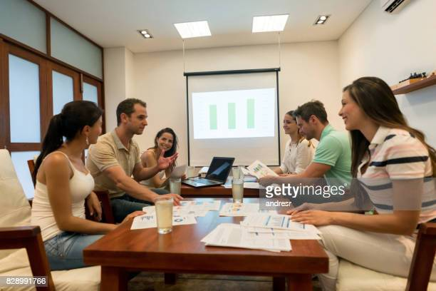 Happy group of people in a business meeting