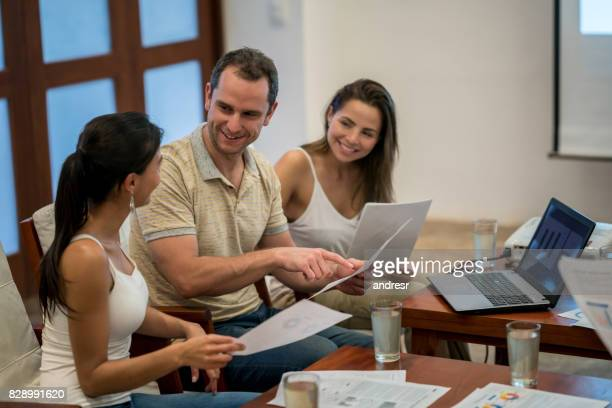 Happy group of people in a casual business meeting