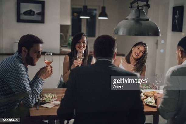 Happy group of people raise their glasses for a toast