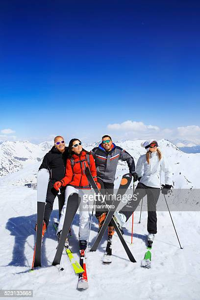 Happy group of snow skiers  Two couples best friends