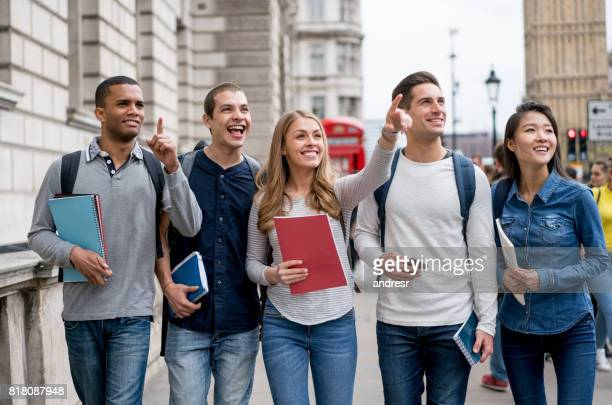 Happy group of students sightseeing in London