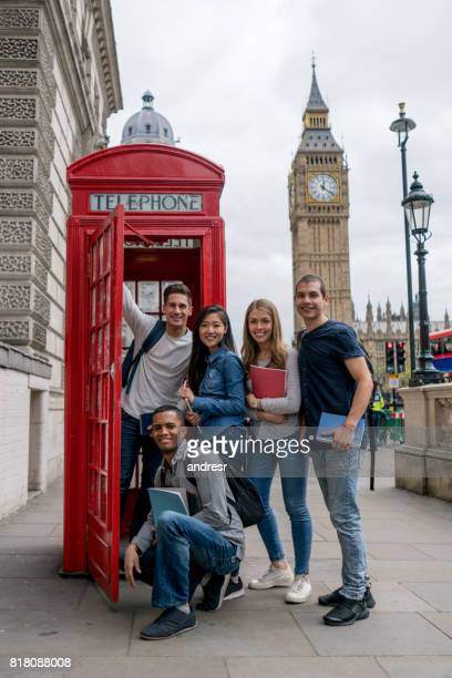 Happy group of students studying in London