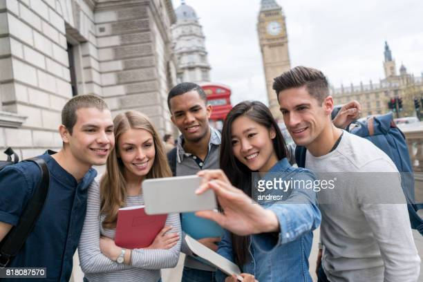Happy group of students taking a selfie in London