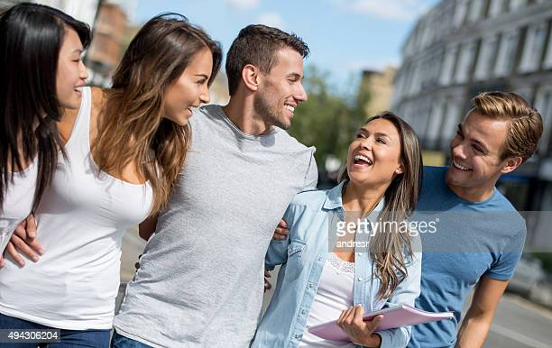Happy group of students walking on the street