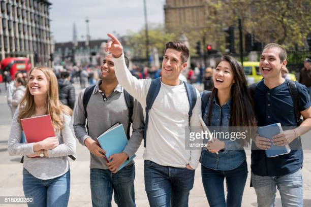 Happy group of students walking outdoors in London