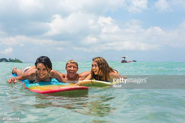 Happy group of Young People Having Fun in the Surf