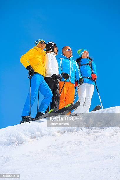 Happy group snow skiers    Best friends enjoying sunny ski resorts