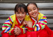 Happy girls in traditional Korean dress (hanbok).