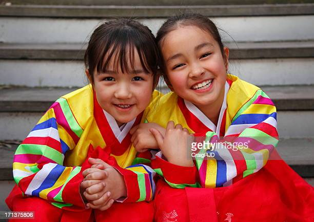 Happy Hanbok - two young girls in colorful dresses smiling