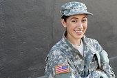 Happy healthy ethnic army female soldier.