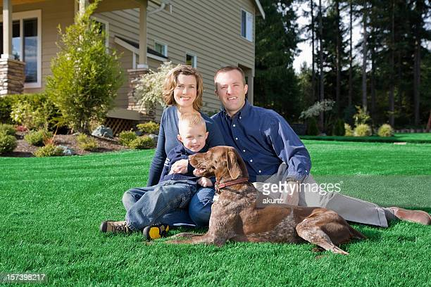 Happy Healthy family Married home landscaped lawn grass dog