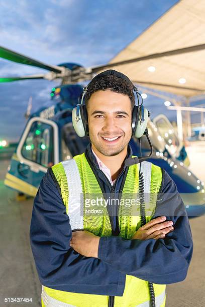 Happy helicopter pilot at the hangar