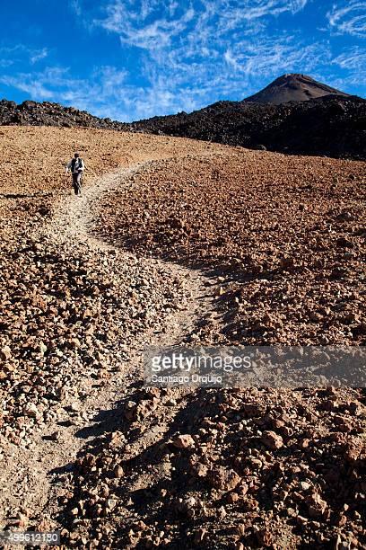 Happy hiker descending from the Teide volcano