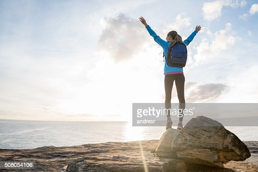 Happy hiker reaching the top