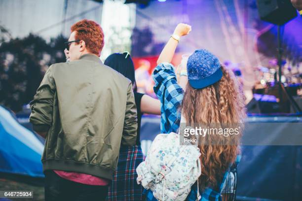 Happy hipsters dancing to the music