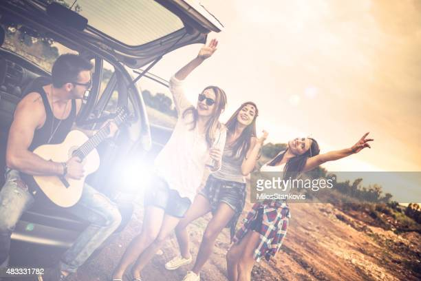 Happy hipsters on a road trip