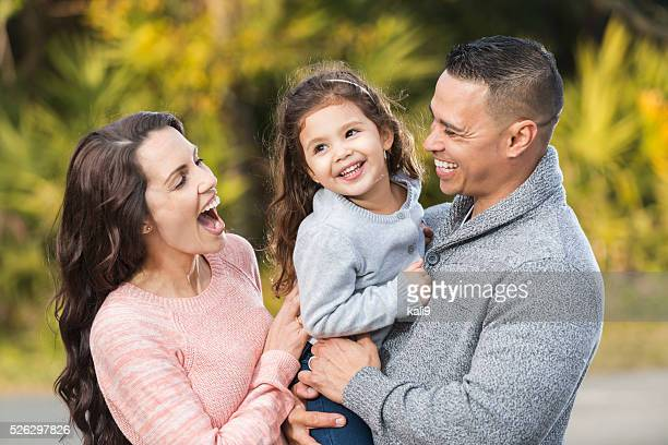 Happy Hispanic family with little girl