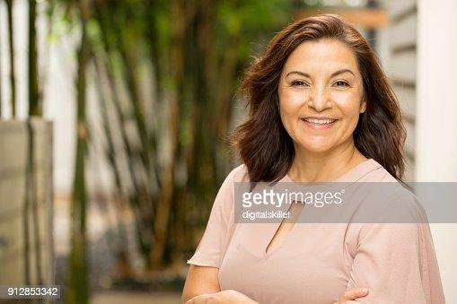 Happy Hispnaic woman smiling. : Stock Photo