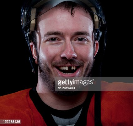 Happy hockey player missing tooth