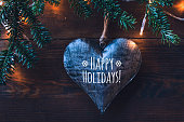 happy holidays greeting card, dark background with heart and love
