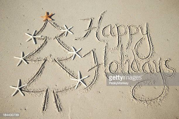 Joyeuses fêtes, arbre Message écrite dans le sable doux