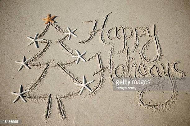 Joyeuses fêtes, arbre de Noël Message dans le sable