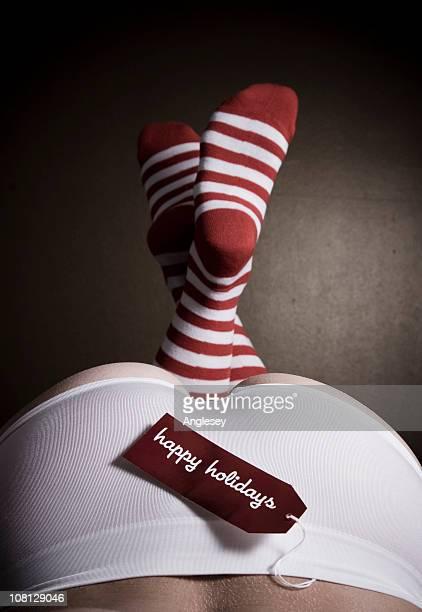 Happy Holidays Tag on Woman's Underwear