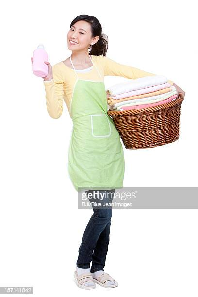 Happy housewife and cleaning products
