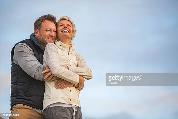 Happy Hugging Middle Aged Active Fit Healthy Beach Couple Outdoors