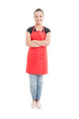 Happy hypermarket seller with confident attitude standing with folded arms isolated on white background