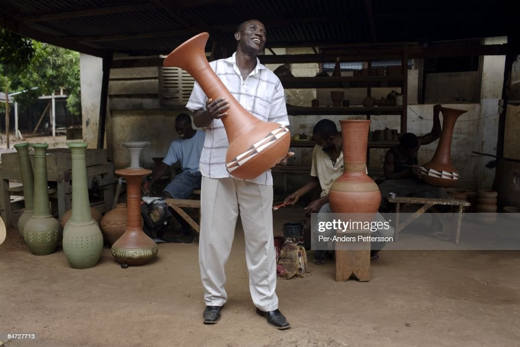 Happy Ideall, the founder of Unique Ceramics Center, holds a Vase in his factory on June 13, 2008 in central Accra, Ghana. He hopes to increase his domestic and export business by working with Herman Chinery-Hesse, a local software entrepreneur, who is pioneering to bringing e-commerce to remote corners of the continent.