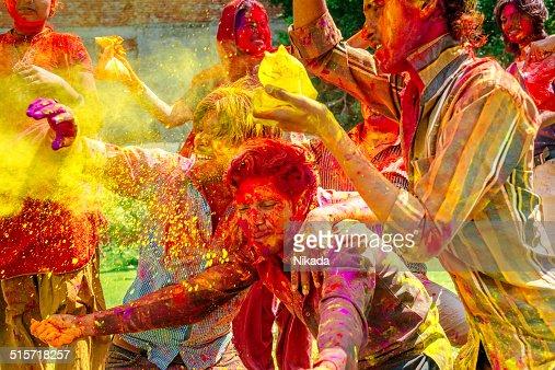 Happy indian people celebrating Holi Festival
