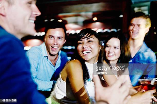 Happy interaction between friends at club bar