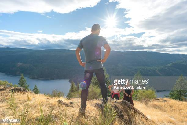 Happy, Interracial Family Enjoying Nature While Hiking on Mountain Top