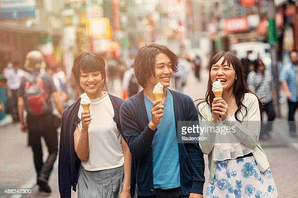 Happy japanese friends eating ice cream