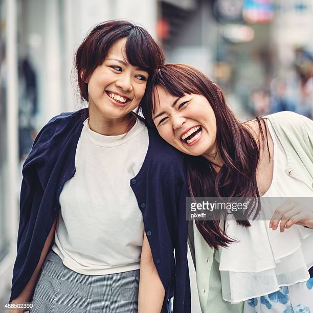 Happy japanese girl friends outdoors in Japan