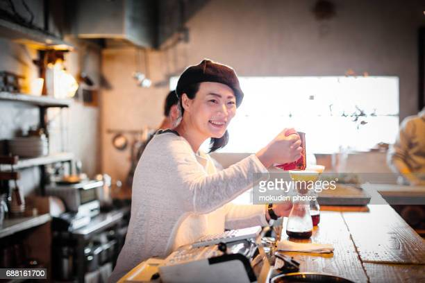Happy Japanese woman cafe owner