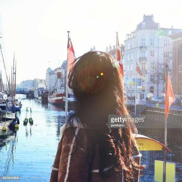 Happy japanese woman tourist in Nyhavn, Copenhagen