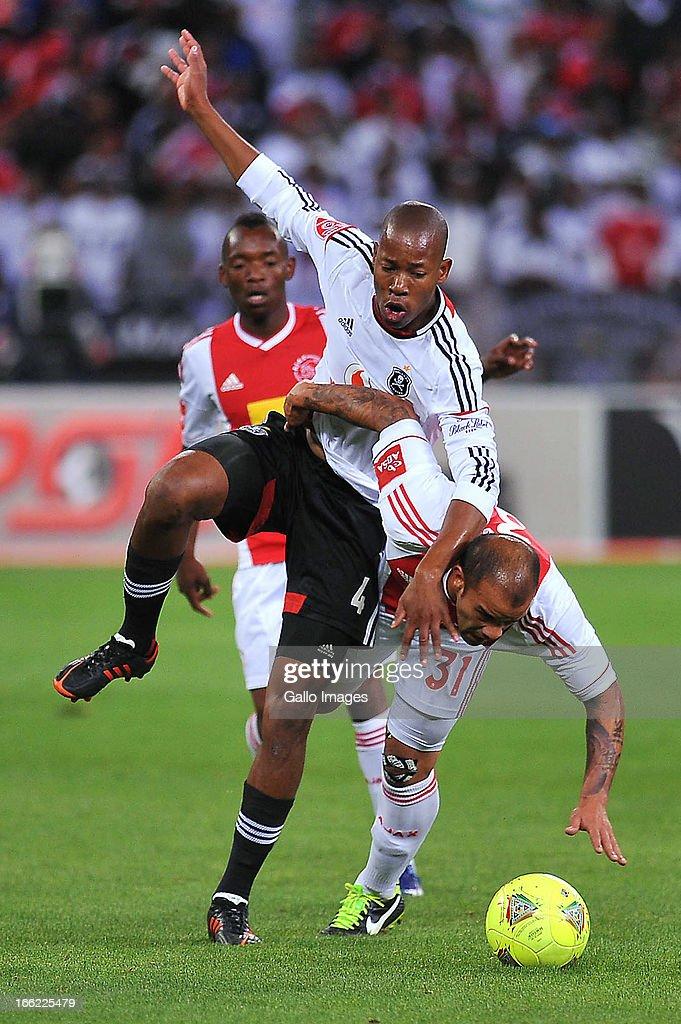 Happy Jele of Orlando Pirates and Lance Davids of Ajax Cape Town in action during the Absa Premiership match between Ajax Cape Town and Orlando Pirates from Cape Town Stadium on April 10, 2013 in Cape Town, South Africa.