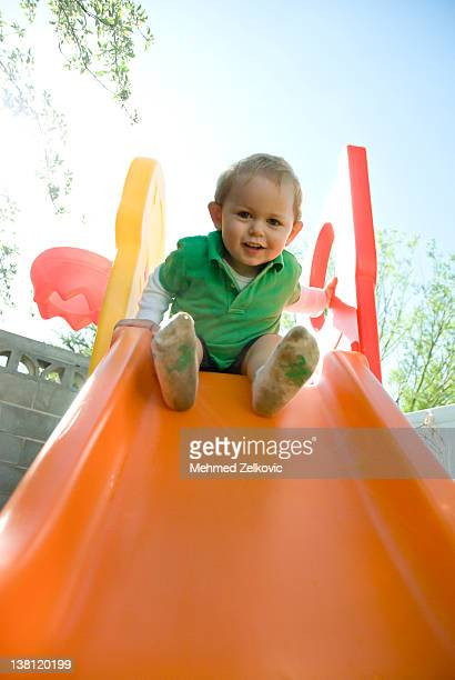 Happy kid on slide