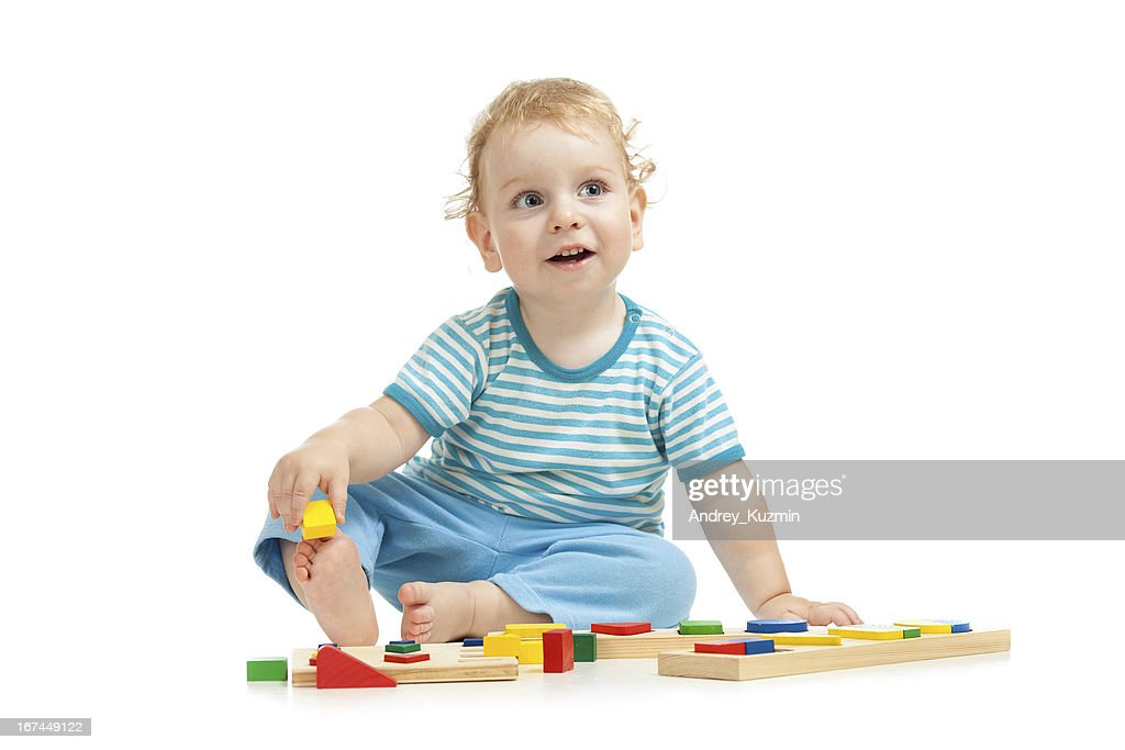 happy kid playing toys : Stock Photo